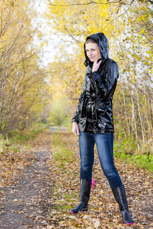 rubber boots: woman wearing rubber boots in autumnal nature Stock Photo