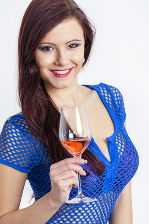 rose wine: portrait of young woman with a glass of rose wine Stock Photo