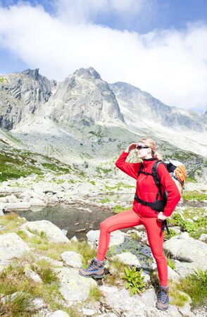 tatras tatry: woman backpacker at Five Spis Tarns, Vysoke Tatry (High Tatras), Slovakia Stock Photo