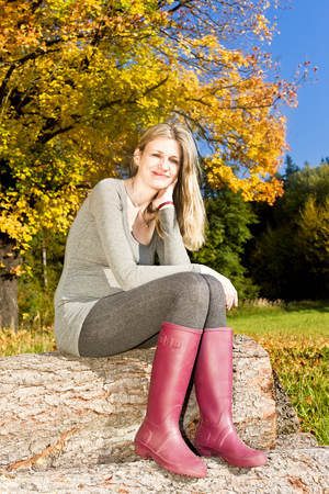 woman sitting in autumnal nature