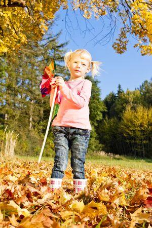 wellingtons: little girl holding a vane