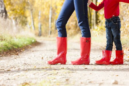 wellingtons: detail of mother and daughter wearing rubber boots