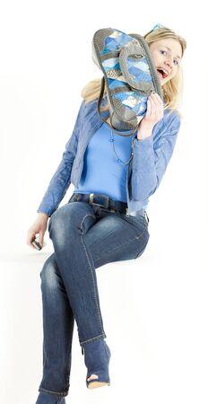 sitting woman with handbag photo