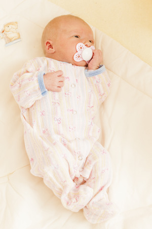 teat: lying newborn baby girl