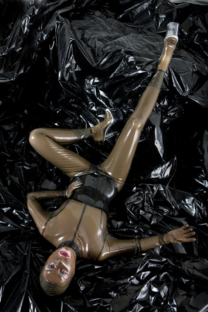 latex woman: woman wearing latex clothes Stock Photo