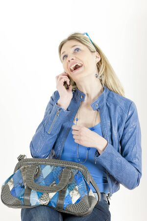 portrait of sitting woman with mobile phone and handbag photo