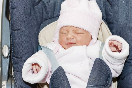 seat belt: portrait of newborn baby girl in a car seat Stock Photo