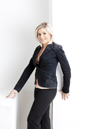 portrait of standing young businesswoman photo