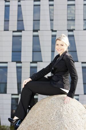sitting young businesswoman photo