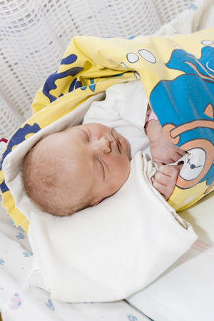swaddling: portrait of a newborn baby girl in maternal hospital Stock Photo