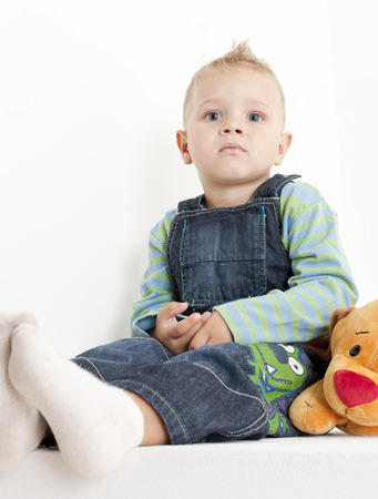 infantile: sitting toddler with a toy