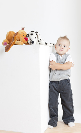 defenseless: standing toddler with toys