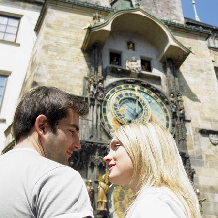 staromestke namesti: couple in Prague, Horloge, Old Town Hall, Czech Republic