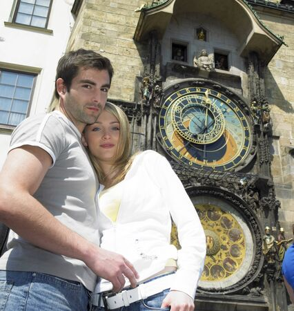lighthearted: couple in Prague, Horloge, Old Town Hall, Czech Republic