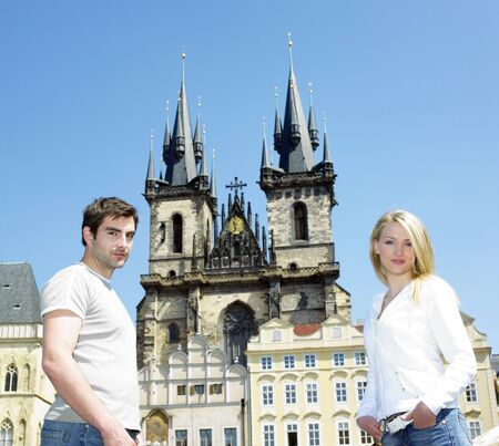 staromestke namesti: couple in Prague, Tynsky church, Old Town Square, Czech Republic