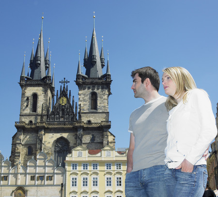 gothic build: couple in Prague, Tynsky church, Old Town Square, Czech Republic