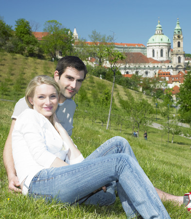 spiritual architecture: couple in Prague, St. Nicholas church, Prague, Czech Republic