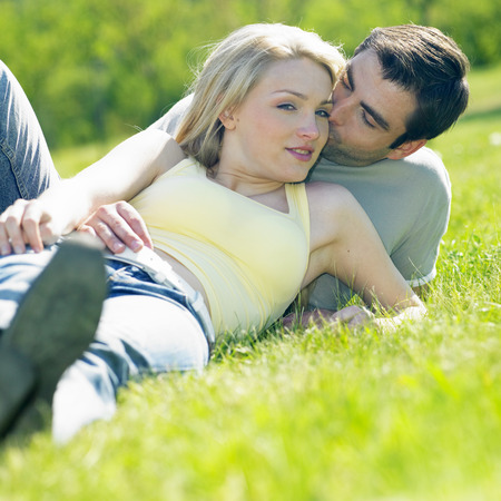 truelove: couple lying on meadow Stock Photo