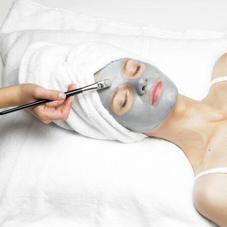 facial: woman with facial mask Stock Photo