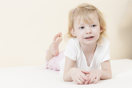 pants down: portrait of lying little girl