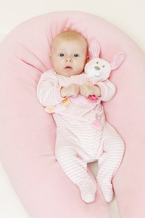 three months old: three months old baby girl holding a toy