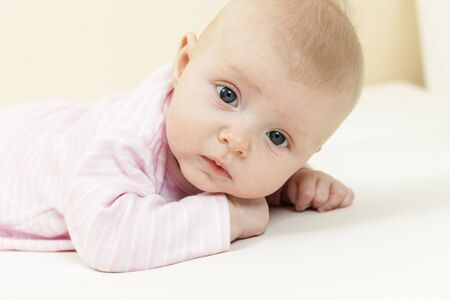 three months old: portrait of lying three months old baby girl