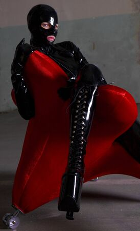 woman in latex sitting in the armchair