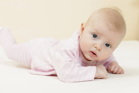 rompers: three months old baby girl Stock Photo