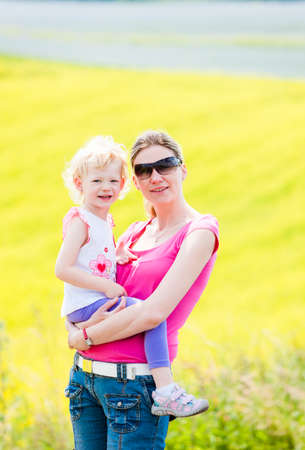 adult rape: mother with her daughter at rape field Stock Photo