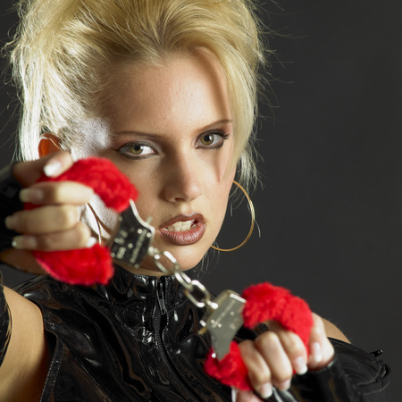 fetishism: womans portrait with handcuffs