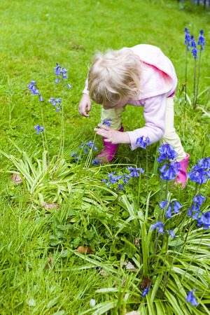 rubber boots: little girl wearing rubber boots in garden