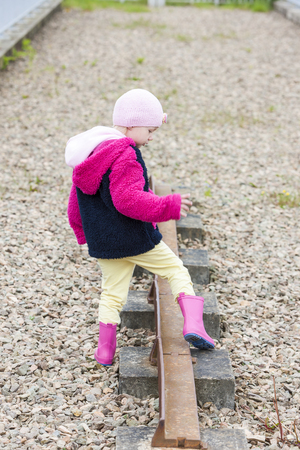 wellingtons: little girl at out of action track on Laigh Milton Viaduct, East Ayrshire, Scotland Stock Photo