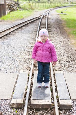 narrow gauge railroad: little girl at Ravenglass and Eskdale narrow gauge railway, Cumbria, England Stock Photo