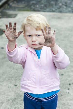 glowering: portrait of dirty little girl Stock Photo