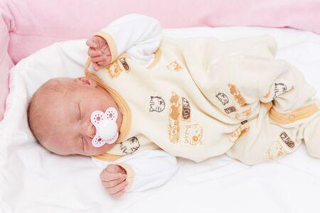teat: sleeping newborn baby girl