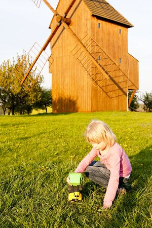 stary: playing little girl at wooden windmill, Stary Poddvorov, Czech Republic