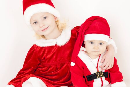 clauses: two little girls as Santa Clauses