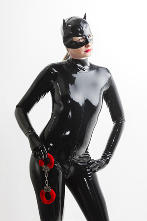 fetishistic: portrait of woman wearing latex clothes with handcuffs