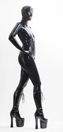 latex: standing woman wearing latex clothes