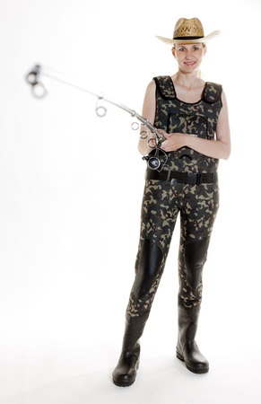 fisher: fisher woman with fishing rod in studio