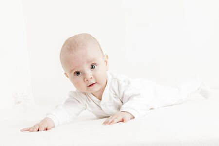 rompers: five months old baby girl Stock Photo