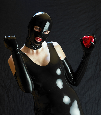 woman in latex with chocolate heart