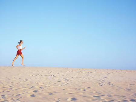 sand dunes: jogging, sand dunes, Corralejo, Fuerteventura, Canary Islands, Spain