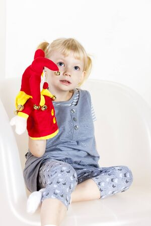 glove puppet: little girl playing with a glove puppet