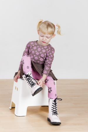skirts: little girl putting on boots
