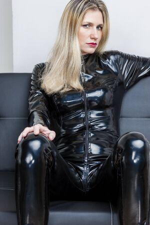 extravagant: portrait of woman wearing black extravagant sitting on sofa