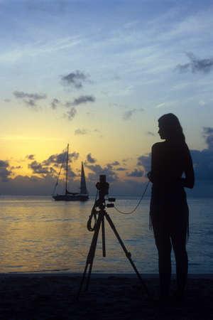 auroral: photographer on the beach