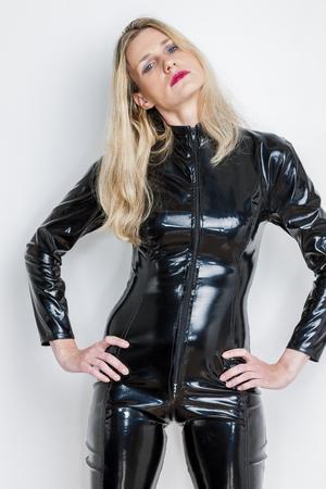 extravagant: portrait of standing woman wearing black extravagant clothes