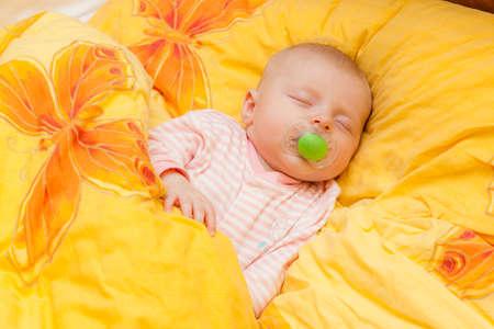 teat: sleeping baby girl in big bed Stock Photo