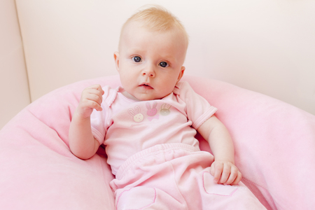 carelessness: portrait of five months old baby girl Stock Photo